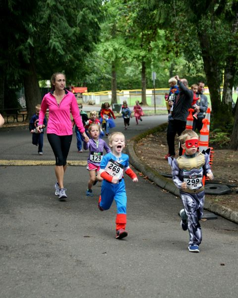 COURTESY OF HERO UP FOR CHILDREN'S CANCER - Some participants in the September 2015 kids' race at Cook Park wore superhero costumes.