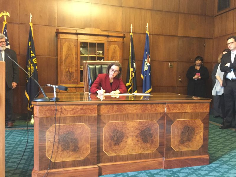 PARIS ACHEN/CAPITAL BUREAU - (File phot) Gov. Kate Brown signs an executive order in her ceremonial office at the Oregon State Capitol in Salem Feb. 2, 2017.