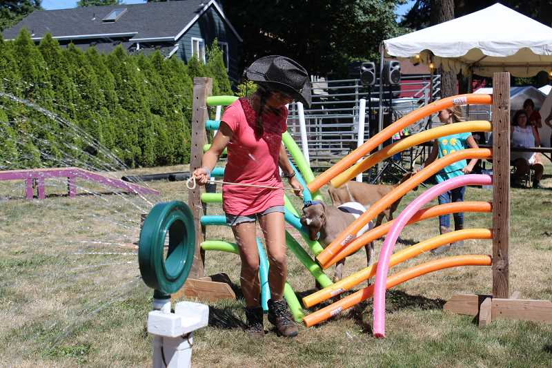 PIONEER PHOTO: KRISTEN WOHLERS - The course included bridges, a sprinkler, this noodle obstacle and more.
