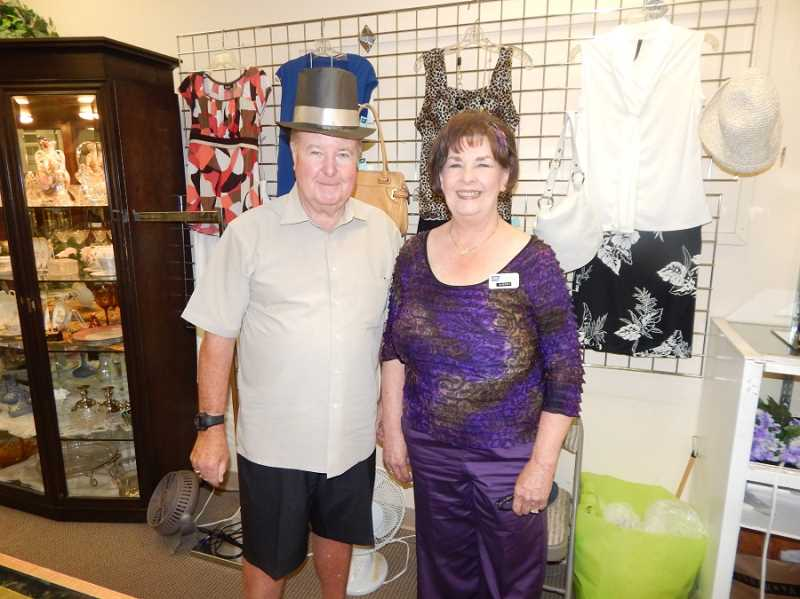 BARBARA SHERMAN - Wearing a top hat, the dapper Dudley Strain, standing with his co-worker Sherry Shelton at the American Cancer Society Discovery Shop in the Willowbrook Center, is ready to for his shift, filling in for his wife Sharon Strain, who was out of town.