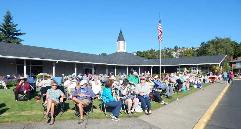 BARBARA SHERMAN - The front lawn of the King City Clubhouse was filled with residents and guests around 9:15 a.m. on Aug. 21 as the solar eclipse was starting.