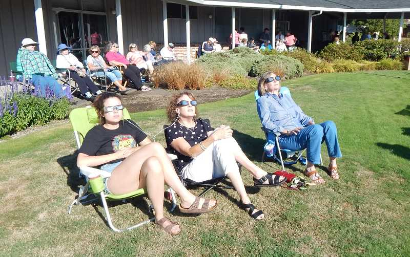BARBARA SHERMAN - Armed with lawn chairs and eclipse glasses, these three women found a great spot in the middle of the King City Clubhouse lawn to view the solar eclipse.