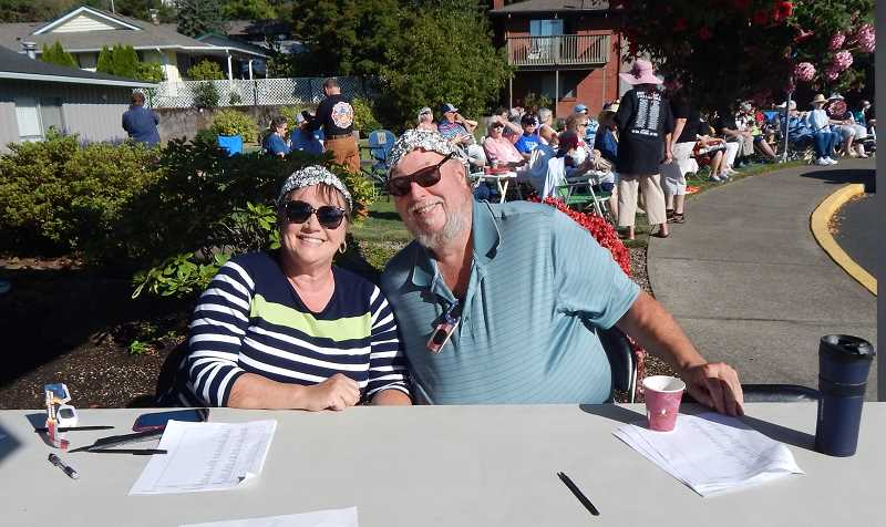 BARBARA SHERMAN - Wendy and Bob Marchant were checking in visitors and handing out eclipse glasses in front of the King City Clubhouse, and from the look of their aluminum foil hats, they also were ready to make contact with artificial intelligence.