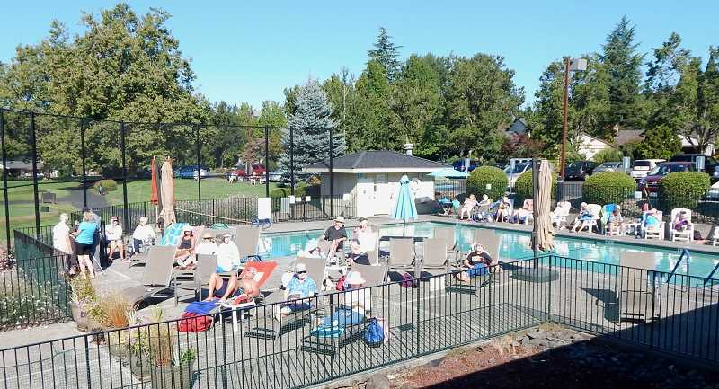 BARBARA SHERMAN - Some Summerfield residents found the Clubhouse swimming pool a great spot to wait for the solar eclipse as it came into view.