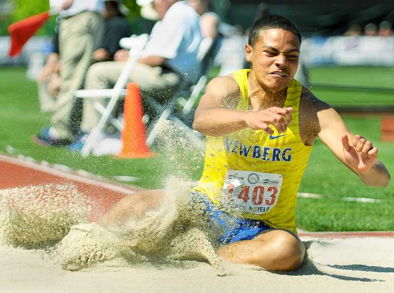 GRAPHIC FILE PHOTO - Taylor Howard splashes into the triple jump pit at Hayward Field en route to a fifth-place finish at the 6A state championships. Howard will compete for George Fox next year.
