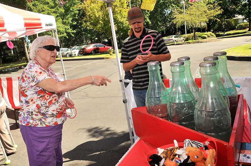 SPOKESMAN PHOTO: VERN UYETAKE - Terese Green shows her skill at the ring toss.