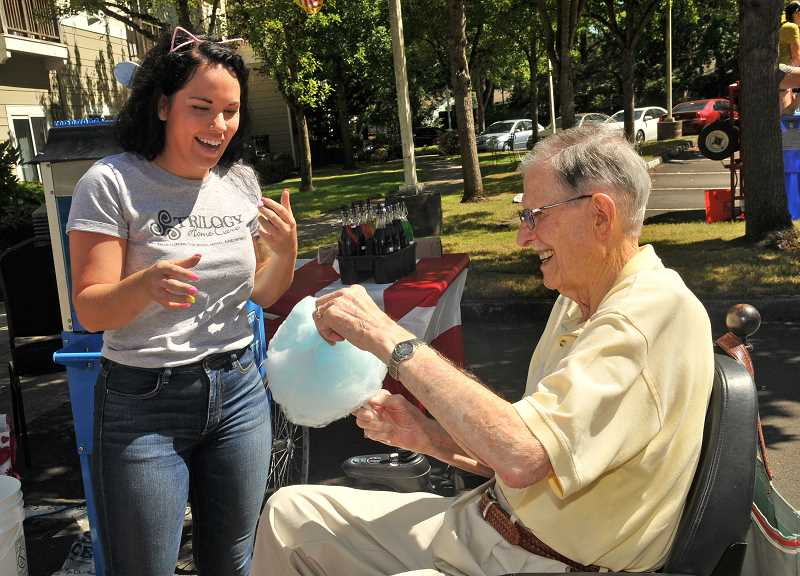 SPOKESMAN PHOTOS: VERN UYETAKE - Carolynn Parker delights Owen Moses with some cotton candy.