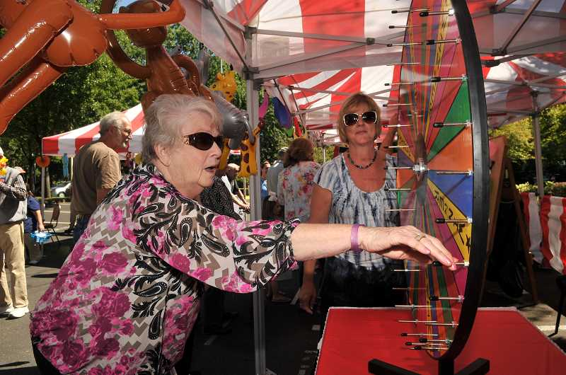 SPOKESMAN PHOTOS: VERN UYETAKE - Marilynn Perkett tries her luck as she spins for a prize.