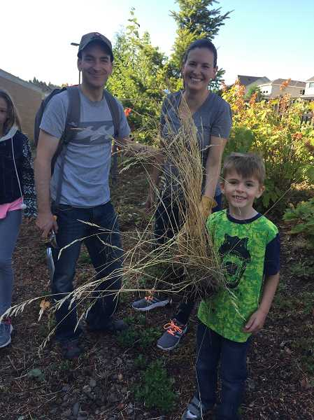 People of all ages helped pull weeds and complete yardwork Saturday, Aug. 19.