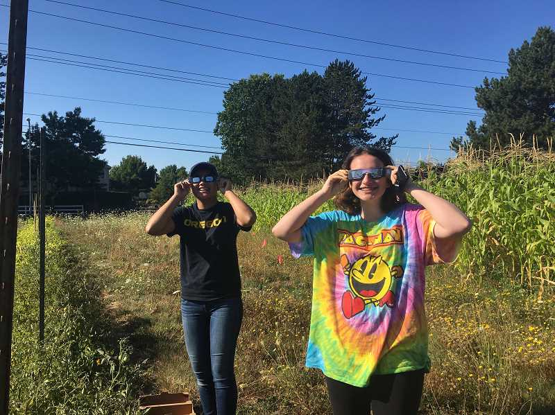 SUBMITTED PHOTO - CREST interns take a break from their work to enjoy the solar eclipse Monday, Aug. 21.