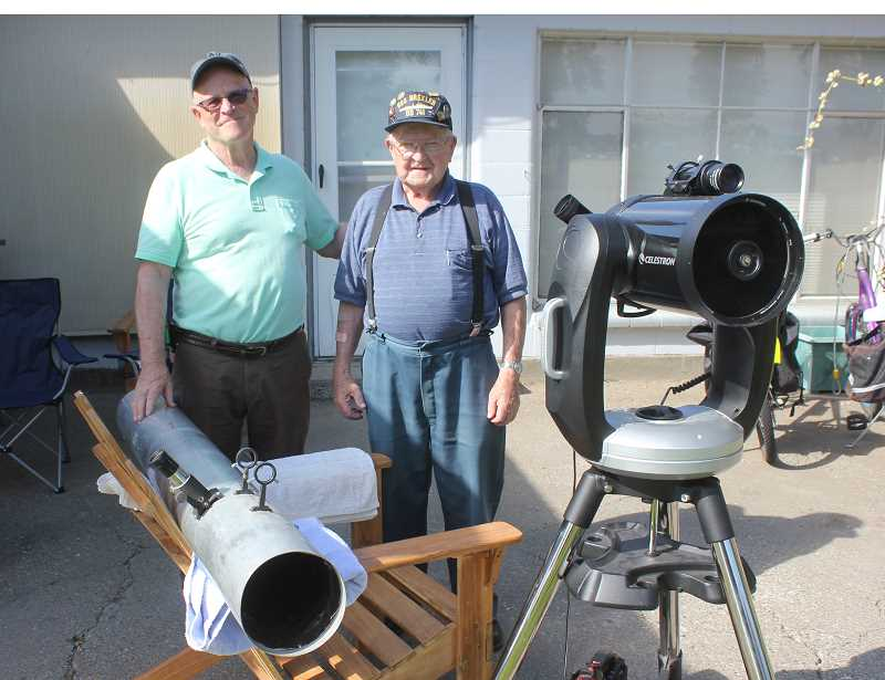 SUSAN MATHENY/MADRAS PIONEER - Madras residents Bartt Brick, left, and his dad, Gene Brick, set up the telescope they built 54 years ago (on chair) and a recently purchased computerized telescope to get ready for a family gathering and solar eclipse viewing Aug. 21, at Bartt and Katherine Brick's house.