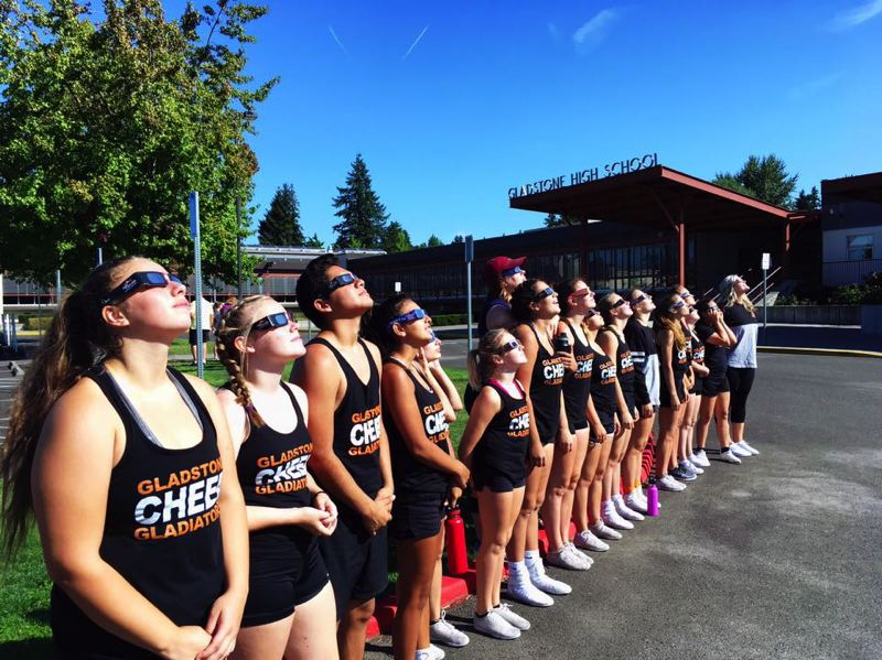 LESLIE ROBINETTE - On Aug. 21, the Gladstone Cheer team took a break from practice to watch the solar eclipse.