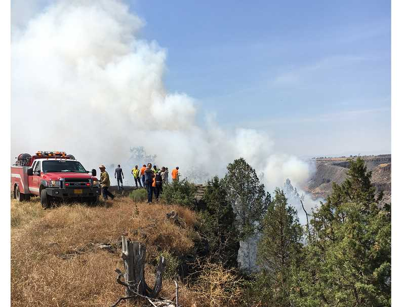 PHOTO COURTESY OF JCSO - The Jefferson County Fire Department, Jefferson County Sheriff's Office, and local officials respond on Saturday, Aug. 19, to the crash of a small aircraft in the Willow Creek Canyon. The plane was headed to the Solar Port activities at the Madras Municipal Airport.