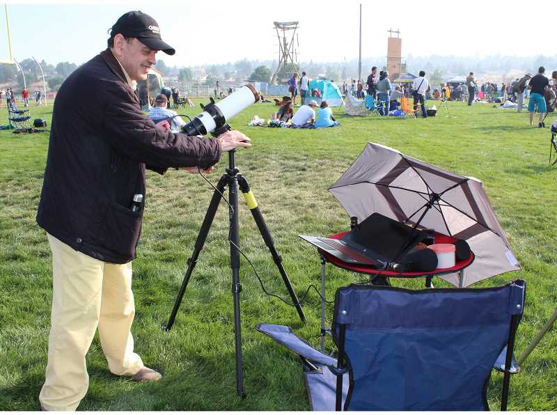 HOLLY M. GILL - Otto Gruebl, of New Zealand, prepares his Lunt telescope and specially programmed computer to record the total solar eclipse.