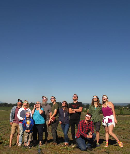 TIMES PHOTO: BRIANA BAYER - A crowd gathers in a field to watch the total eclipse.