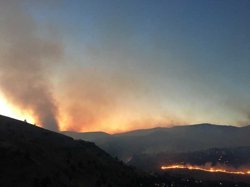 ROBYN BROYLES - A column of smoke rises from the Nena Springs Fire as it moves across Indian Creek Canyon on Aug. 18. The fire, on the Warm Springs Reservation, has burned 68,135 acres, and is now 75 percent contained.