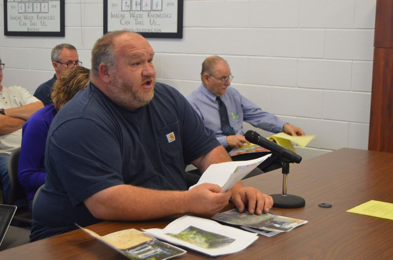 SPOTLIGHT PHOTO: COURTNEY VAUGHN - Don Campbell, who appealed a county land use decision regarding a mobile home park's septic system, addresses county commissioners during a public hearing Wednesday, Aug. 23.