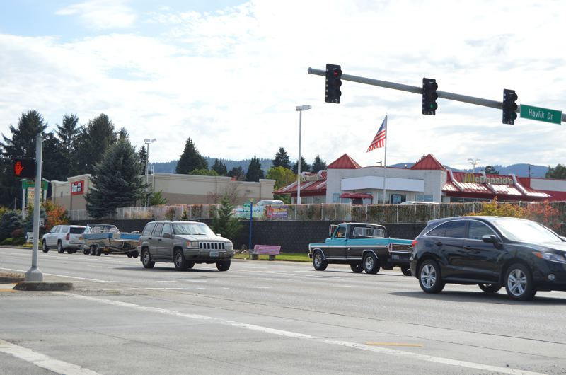 SPOTLIGHT PHOTO: COURTNEY VAUGHN - Traffic on Highway 30 in Scappoose could get a break thanks to newly installed permissive left turn signals. Motorists can now use the flashing yellow signals at lights to make discretionary turns if traffic conditions permit.