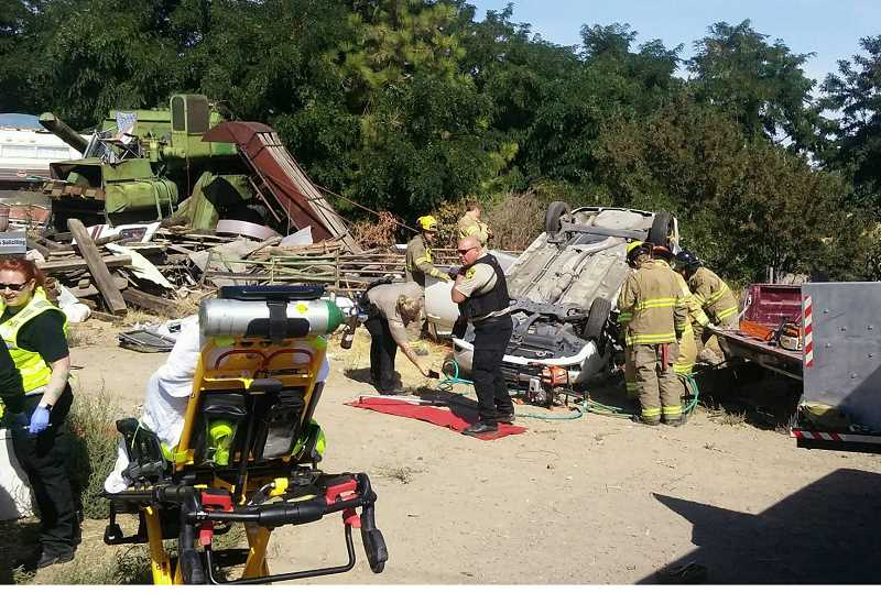 SUBMITTED PHOTO - Rescue workers had to remove two people from an overturned vehicle at Highway 361 and Bear Drive on Aug. 20.