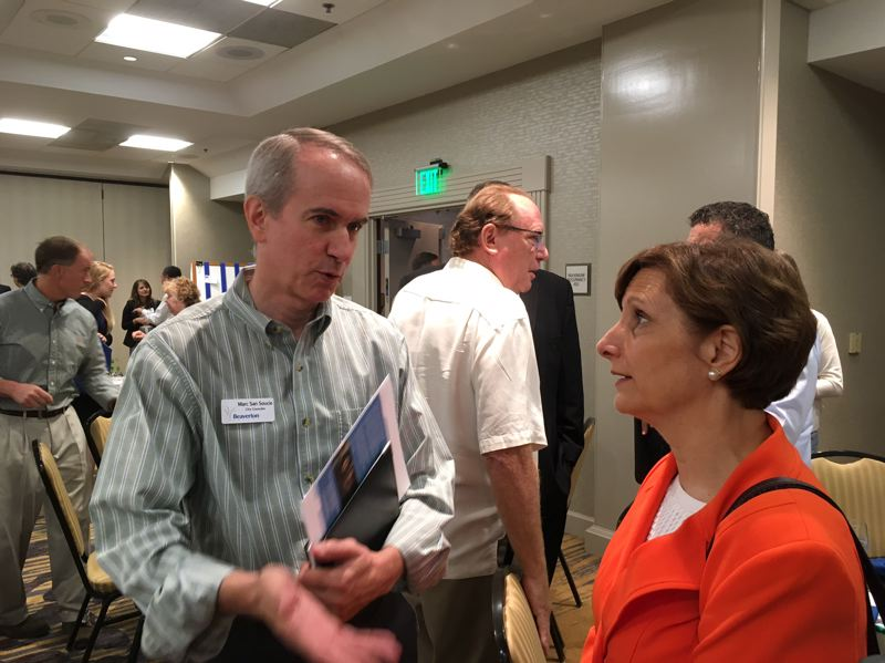 PAMPLIN MEDIA GROUP: PETER WONG - Beaverton City Councilor Marc San Souci speaks with U.S. Rep. Suzanne Bonamici, D-Ore., after her talk at a Westside Economic Alliance breakfast Thursday (Aug. 24) at Embassy Suites in Tigard.