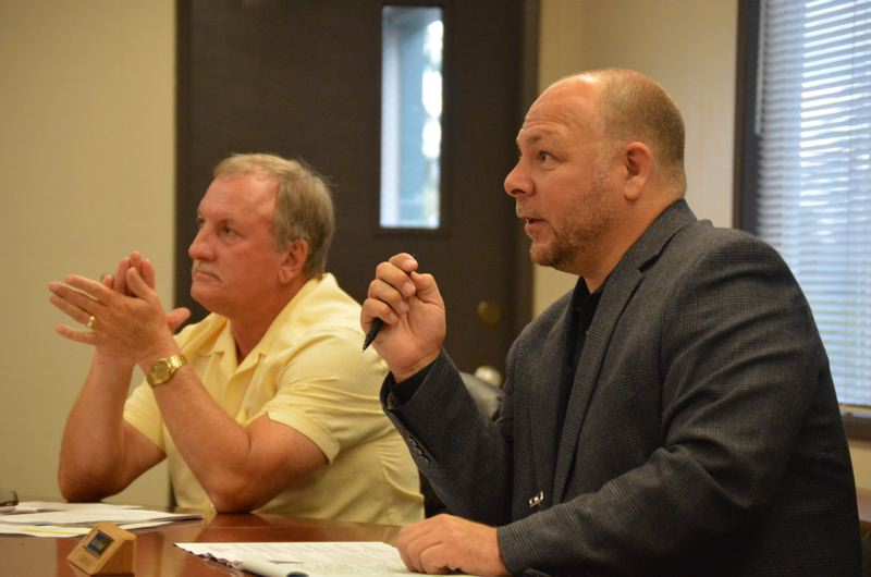 SPOTLIGHT PHOTO: NICOLE THILL - Superintendent Scot Stockwell, right, speaks during a St. Helens School District Board meeting on Wednesday, Aug. 23. Stockwell made several interim appointments to key admintrative roles in the district that were left vacant over the summer.