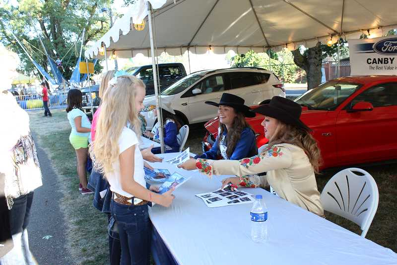 PHOTO BY KRISTEN WOHLERS - Miss Rodeo Oregon 2017 Kayla Vincent and the Miss Rodeo Oregon 2018 contestants spent time Thursday, Aug. 17 signing autographs at the Clackamas County Fair.