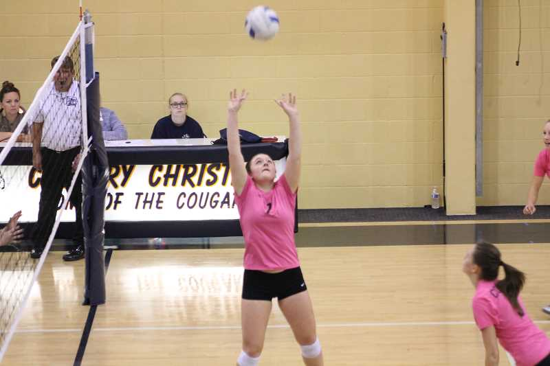 PIONEER PHOTO: CONNER WILLIAMS - Country Christian senior Maddy Weyer sets the ball during a home game last season.