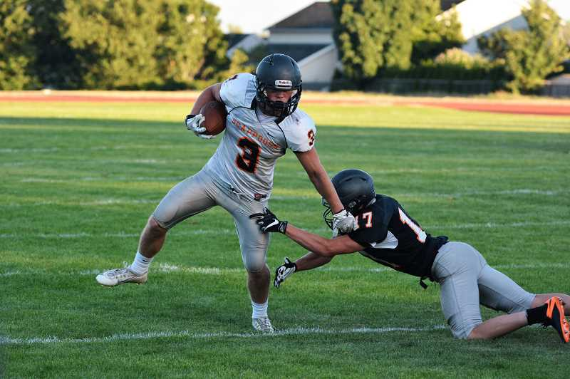 SPOTLIGHT PHOTO: JAKE MCNEAL - Scappoose football held an intrasquad jamboree on Friday, Aug. 25, at Scappoose High School.