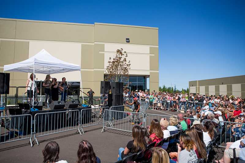PAMPLIN MEDIA GROUP: ADAM WICKHAM - Crowds came in droves to see a concert put on by Wilson Phillips in the parking lot of Love Bites by Carnie, the new bakery/cafe located on Century Drive in Sherwood.