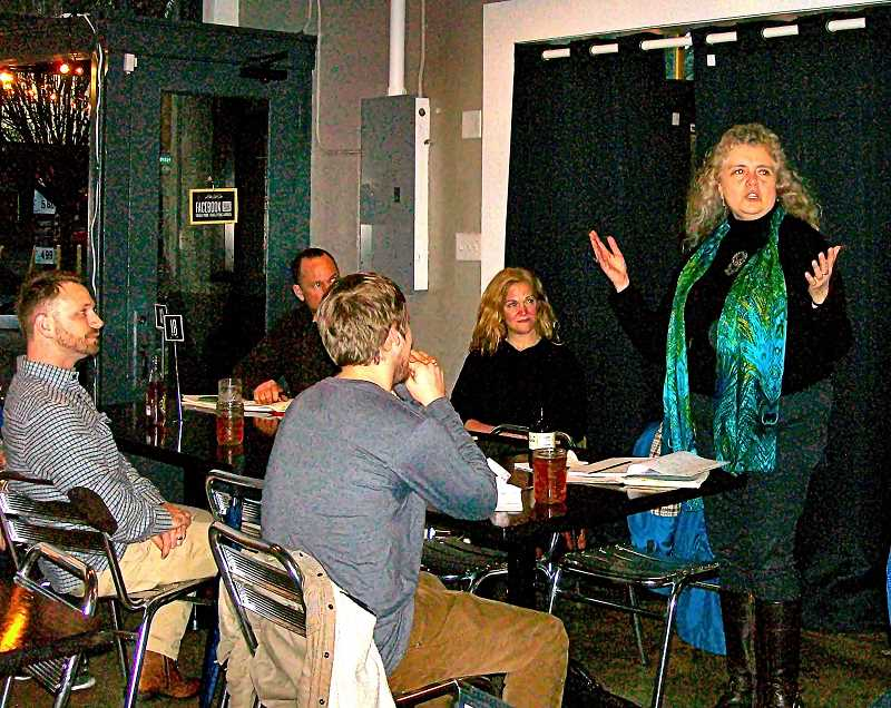 "RITA A. LEONARD - Jean Richardson welcomes poets to a meeting of the monthly ""Shut Up & Eat Open Mic Poetry"" group on S.E. Gladstone Street."