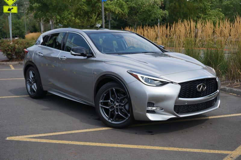PORTLAND TRIBUNE: JEFF ZURSCHMEIDE - The thing that you notice first about the QX30 is that its stance is low like a sports sedan and the lines are just too rakish to be compared with boxy SUVs and crossovers.