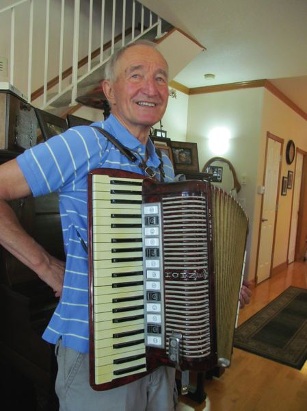 PHOTO BY ELLEN SPITALERI - Leo Hartfeil loves any excuse to break out his accordion and play a rousing polka. He will turn 80 this month.