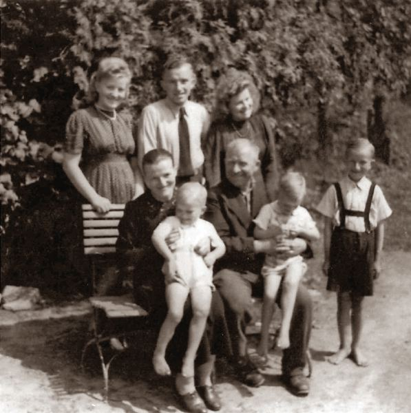 SUBMITTED PHOTO - This photo of Leo Hartfeil's family, circa 1945, shows his mother and father holding the twins with Leo far right. In the back row are his two sisters and older brother.