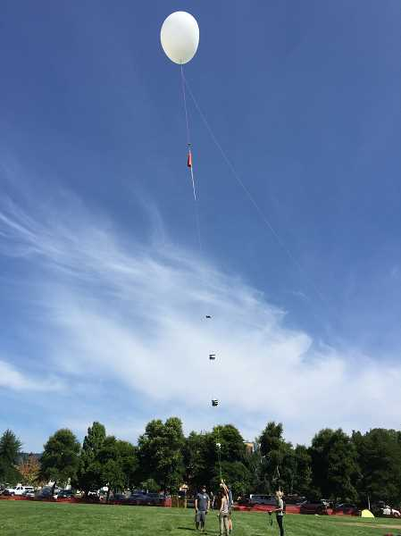 SUBMITTED PHOTO - Oregon Tech students and faculty get ready to launch their balloon Aug. 21, for the Great American Eclipse.