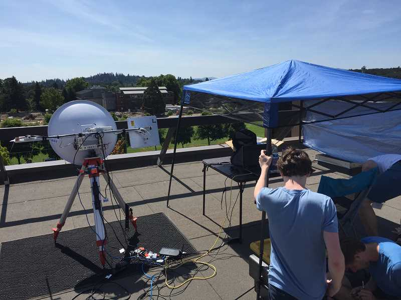SUBMITTED PHOTO - Oregon Techs eclipse team makes some last-second adjustments.