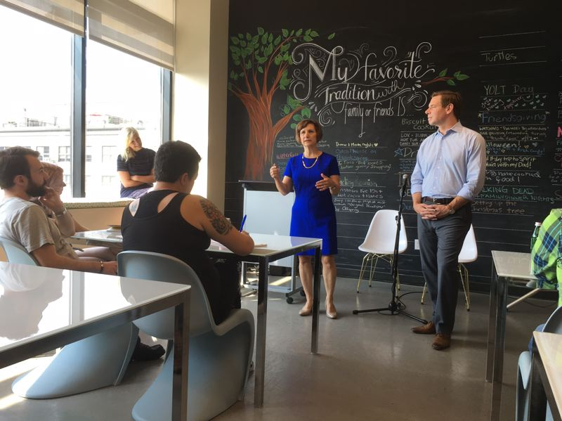 PAMPLIN MEDIA GROUP: PETER WONG - U.S. Reps. Suzanne Bonamici, D-Ore., center, and Eric Swalwell, D-Calif., talk with young workers at Ruby Receptionists in Northwest Portland on Monday, Aug. 28.