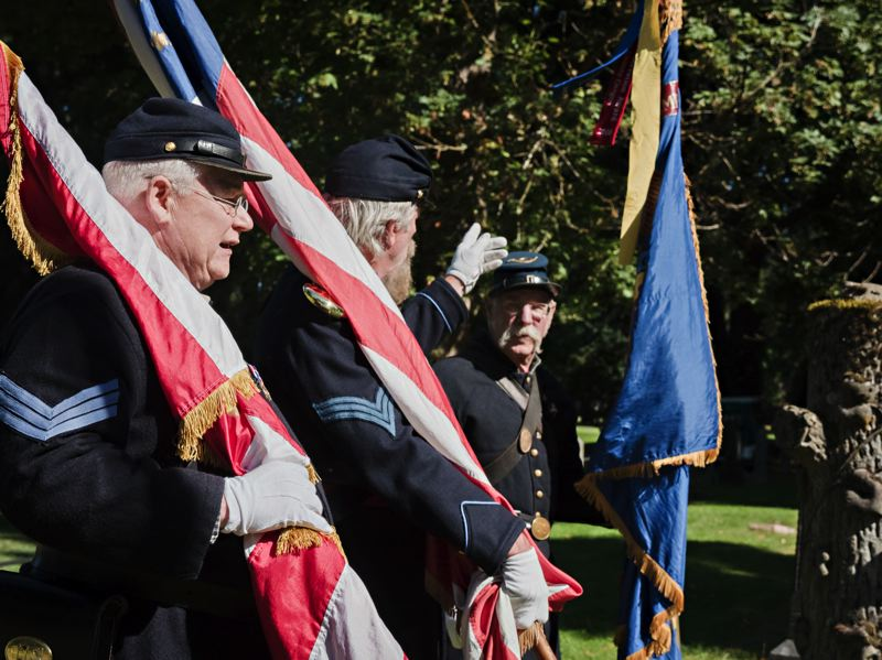 PHOTO BY: JAMIE BOSWORTH - Sons of the Union Veterans conduct a recent ceremony at a cemetery.