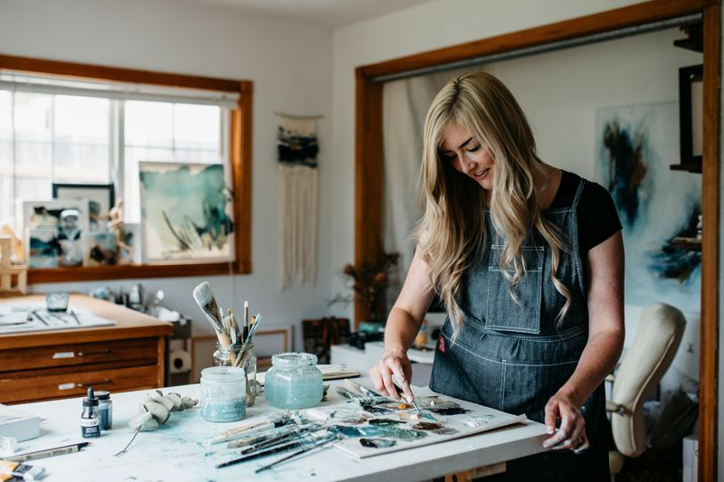 PHOTO BY ELISSA DELINE - Clackamas County resident Monika Kralicek mixes paint to get the perfect colors for her Little By Little pieces to be displayed at Milwaukie's First Friday on Sept. 1.