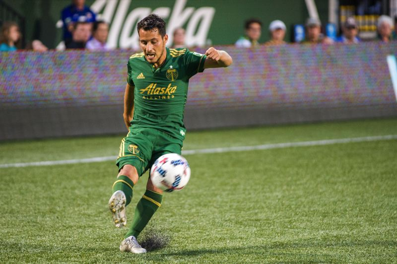 TRIBUNE PHOTO: DIEGO G. DIAZ - Sebastian Blanco sends in a cross for the Portland Timbers in their victory over the Colorado Rapids last wekk.