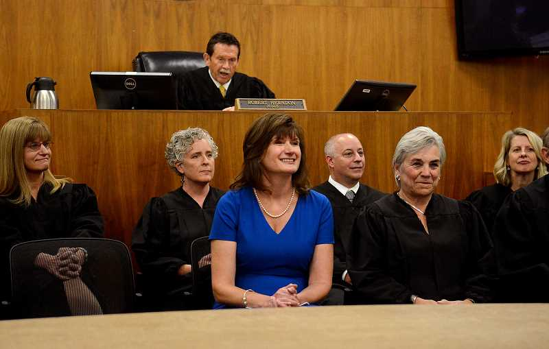 REVIEW PHOTO: VERN UYETAKE - Former state Rep. Ann Lininger sits with Clackamas County Circuit Court judges during introductory remarks at her investiture ceremony Monday by Judge Robert Herndon.