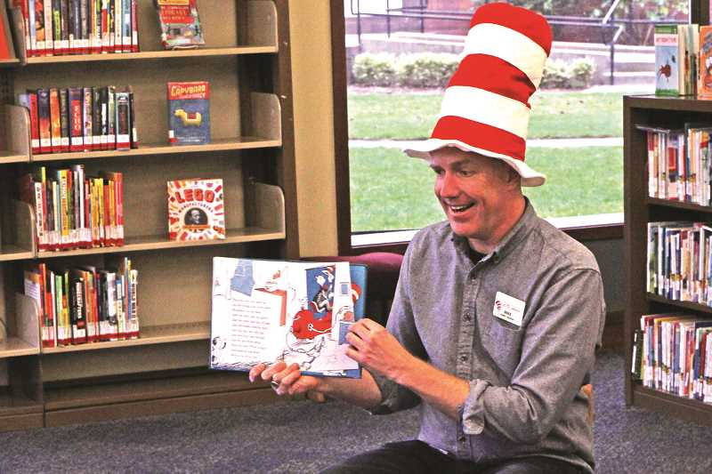INDEPENDENT FILE PHOTO - Mike Jansen, the Woodburn Public Library's children's librarian, is leaving soon to begin work as a substitute teacher in Portland.