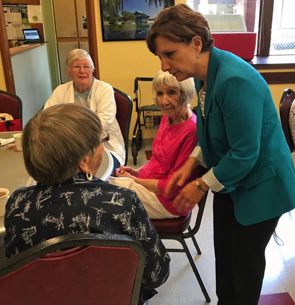 TIMES PHOTO: DANA HAYNES - Congresswoman Suzanne Bonamici discusses issues with the lunch crowd at the Elsie Stuhr Center, part of the Tualatin Hills Parks & Recreation District.