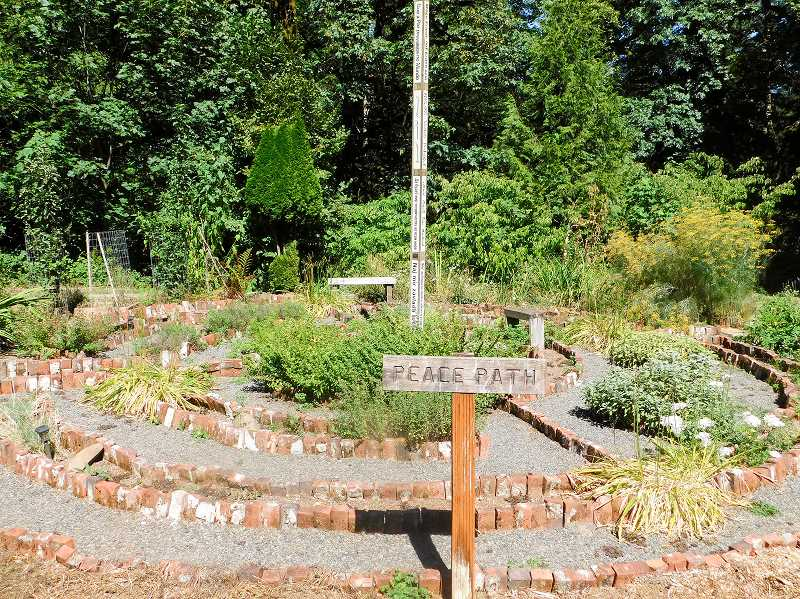 ESTACADA NEWS PHOTO: EMILY LINDSTRAND - The retreat center's peace path features a labyrinth, herb garden and a pole with May Peace Prevail on Earth written on it in multiple languages.