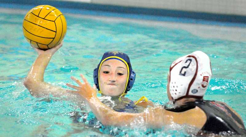 SETH GORDON - MacKenzie Russell attempts a pass during Newberg's dramatic 10-9 double overtime victory over Westview in the season opener Monday night at the Chehalem Aquatic Center. Russell scored the first of Newberg's two goals in the final minute, which forced overtime.