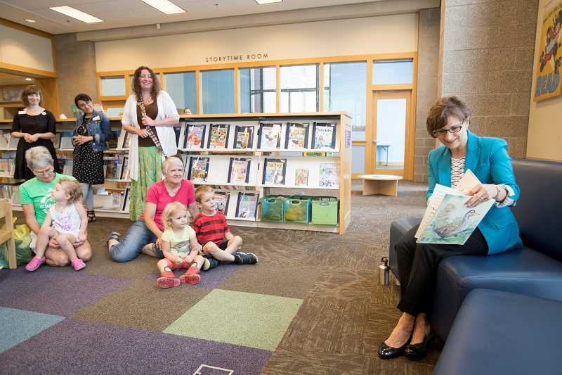 TIMES PHOTO: JAIME VALDEZ - Rep. Suzanne Bonamici reads to children during storytime at Beaverton City Library on Tuesday morning.