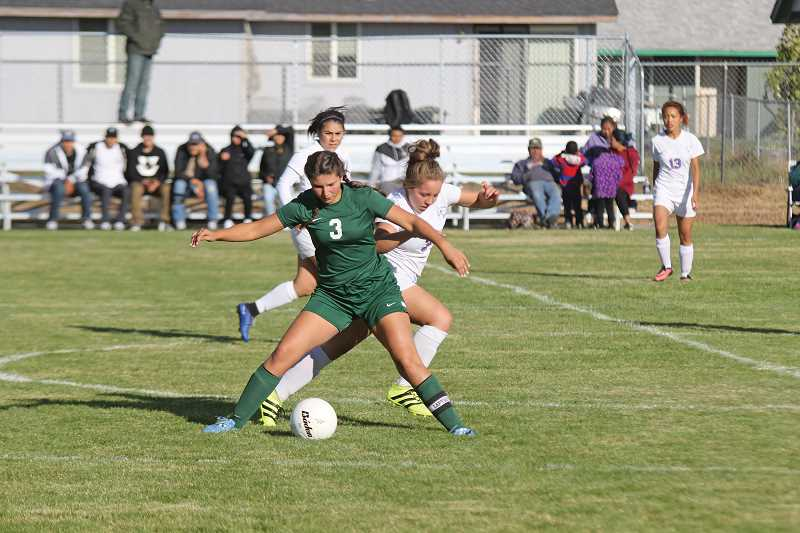 PIONEER FILE PHOTO - Madras senior Alesha Freeman (foreground, right) will be called on to anchor and lead the Buffs' defense from her center back position.