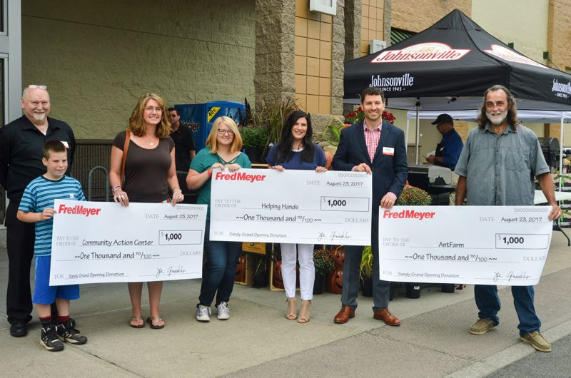 POST PHOTO: CLARA HOWELL - Sandy Community Action Center, Sandy Helping Hands and AntFarm were the three nonprofit organizations that each received a donation of $1,000 from Fred Meyer.