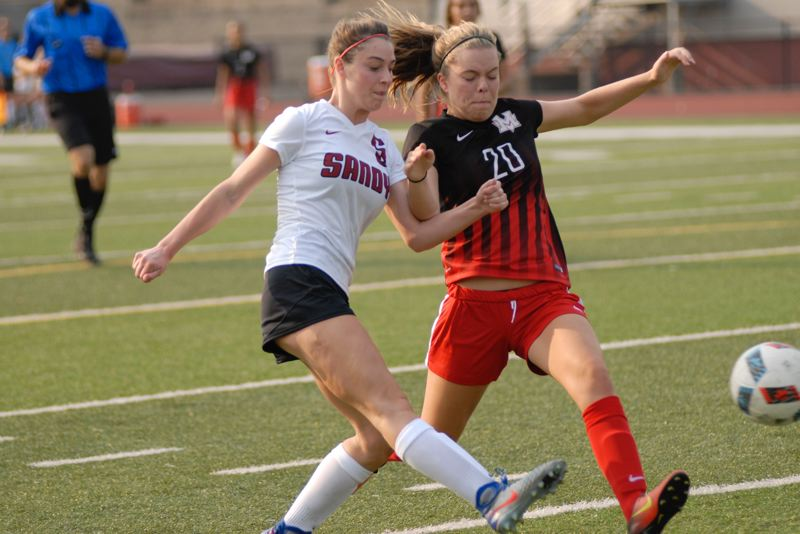 SANDY POST: MATT RAWLINGS - Sandy's Natalie Paul pushes the ball forward against a Mountain View defender.