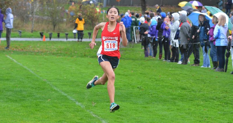 TIMES FILE PHOTO - Westview sophomore Irene Nagasaka leads an experience, talented group of Wildcats on the cross country course.