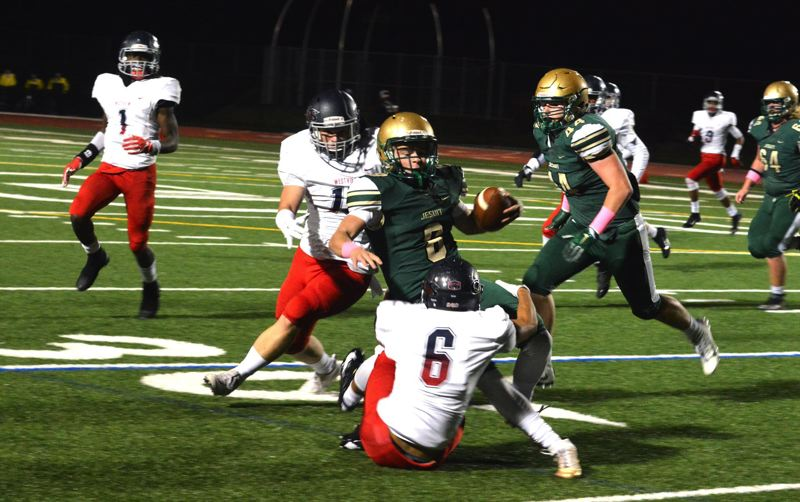 TIMES FILE PHOTO - Jesuit junior quarterback Will Spitznagel and the Crusaders will tussle with Tigard on Friday at Jesuit High School.